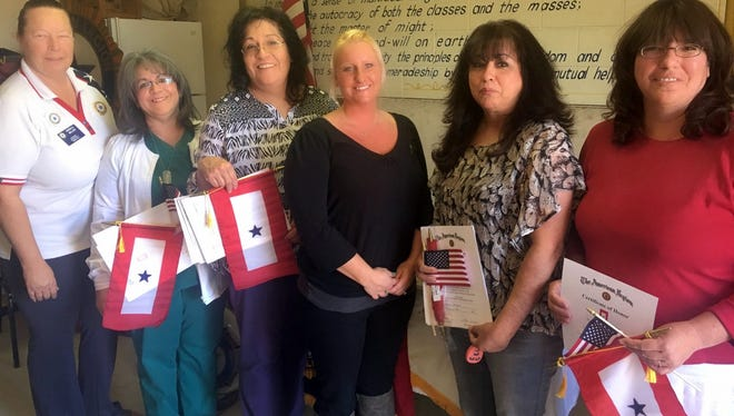 Pictured from left are: Bataan Unit 4 President Gwen Miller, Mayra Srader, Patricia Juarez, Blue Star Banner Chair Laura Jones, Jannie Snyder and Margaret Borden.