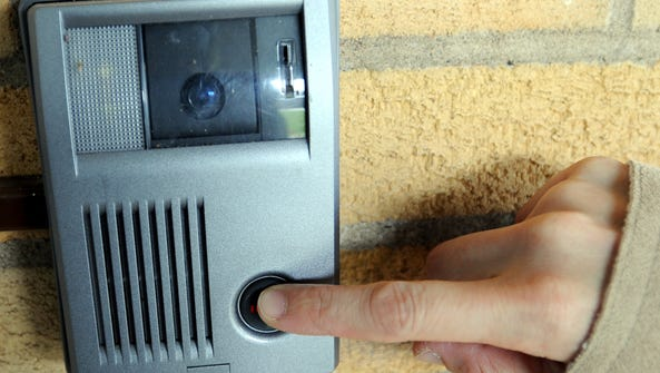 Visitors must ring a buzzer to gain entry into many