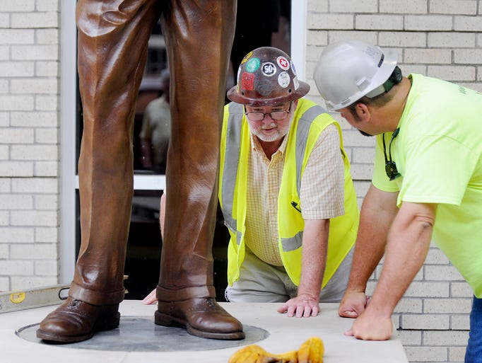 Project Superintendent for Roy Anderson Corporation's Bill Keyes, left, and field engineer Doug Odom talk about the specifics of the Frank Day statue Friday, at the site of the University of Southern Mississippi's new Century Park South residence complex. Frank Day is the founder of the Luckyday Foundation which has funded the Luckyday Scholarships that are presented to students every year.