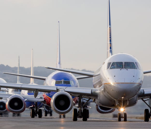 Jets line up for departure during at San Francisco International Airport on Oct. 23, 2016.