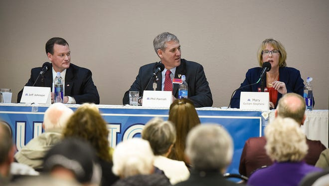 GOP candidates for Minnesota governor Jeff Johnson, Phil Parrish and Mary Guiliani Stevens take turns answering questions Wednesday, April 18, during a candidate debate at the Tuscan Center in Midtown Square.