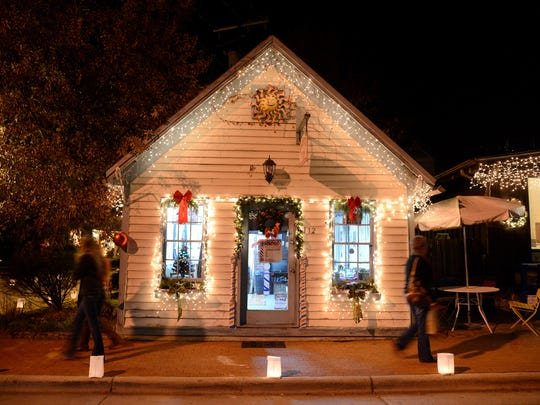 Holiday shoppers walks along Front Street in Dillsboro