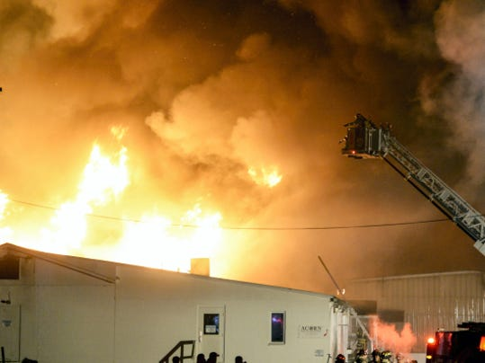 Fire crews from three counties battle a massive blaze at Acorn Manufacturing, 24 Terry Lane, in South Londonderry Township on Thursday. Water had to be trucked in by tankers to extinguish the blaze that engulfed a 55,000-square-foot structure. The business was recently renamed Bench Dogs.