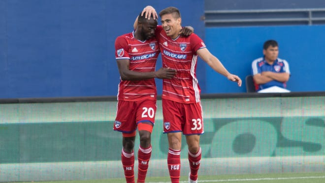 Aaron Guillen (33) celebrates with Roland Lamah (20) after a goal against Real Salt Lake on June 3, 2017.