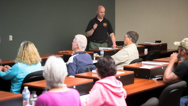 Major Brent Barlow with the Doña Ana County Sheriff's Department, talks to members of the public at the Sheriff's office, May 7, 2016, during a one-day class on the use of force in police work. The class, which was free and open to the public and is designed to educate the community in the decisions law enforcement officers are trained to make, is offered every few months by the Sheriff's office. Groups interested in taking part in the class should contact Doña Ana County Sheriff's Department Communications Specialist Kelly Jameson at kellyj@donaanacounty.org.