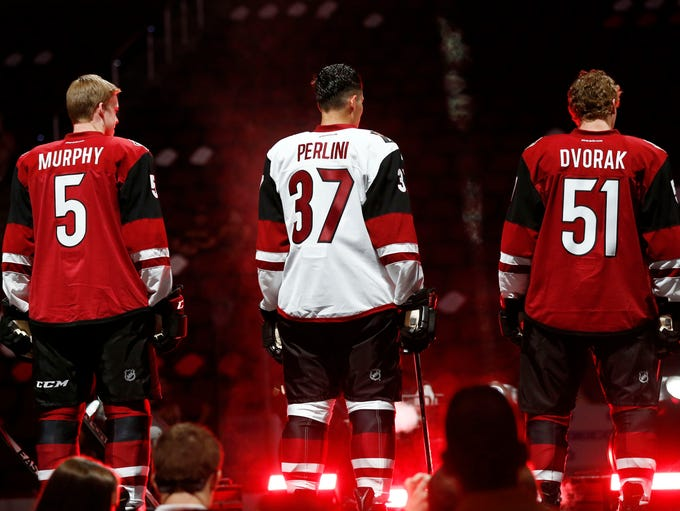 Arizona Coyotes Connor Murphy, Brendan Perlini and