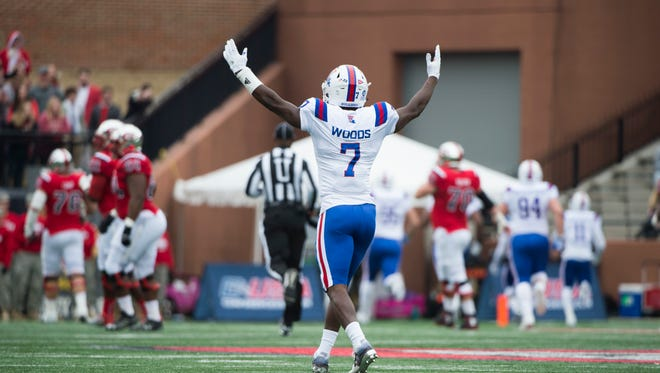 Louisiana Tech safety Xavier Woods (7) cheers as his teammate scores against Western Kentucky in the first half of theConference USA championship NCAA college football game, Saturday, Dec. 3, 2016, at L.T. Smith Stadium in Bowling Green, Ky. (AP Photo/Michael Noble Jr.)