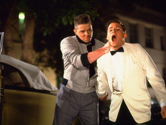 Biff Tannen (Thomas F. Wilson) handles George McFly