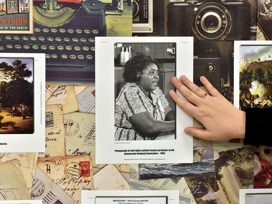 Bentonia Gibbs Elementary teacher Danielle Creel shows some of the historical photographs she uses to incorporate civil rights movement history into her lesson plans Tuesday, Sept. 26, 2017.