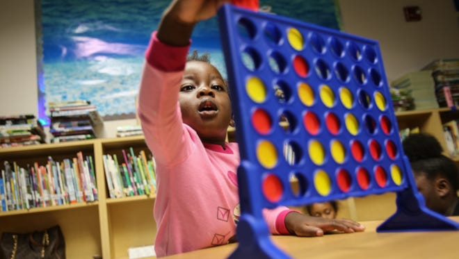 Ivyanna Hall, 2, plays connect four with her family while they wait for Hurricane Irma to pass at the Pinecrest Elementary School shelter Saturday, Sept. 9, 2017. Hundreds of people from across the county took shelter from Hurricane Irma at Pinecrest.