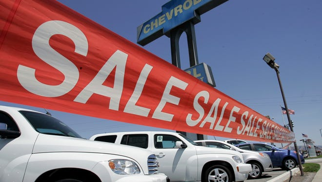 Auto dealers are still thriving despite to a move by consumers to do more of their car shopping over the web