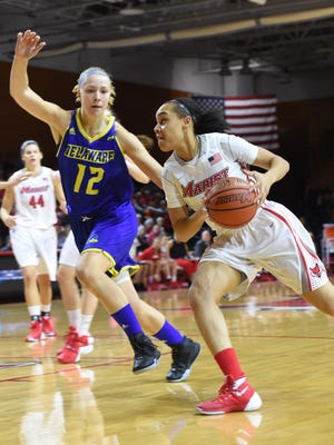 Marist's Sydney Coffey drives to the net past Delaware's Hanna Jardine during Thursday's game at Marist.