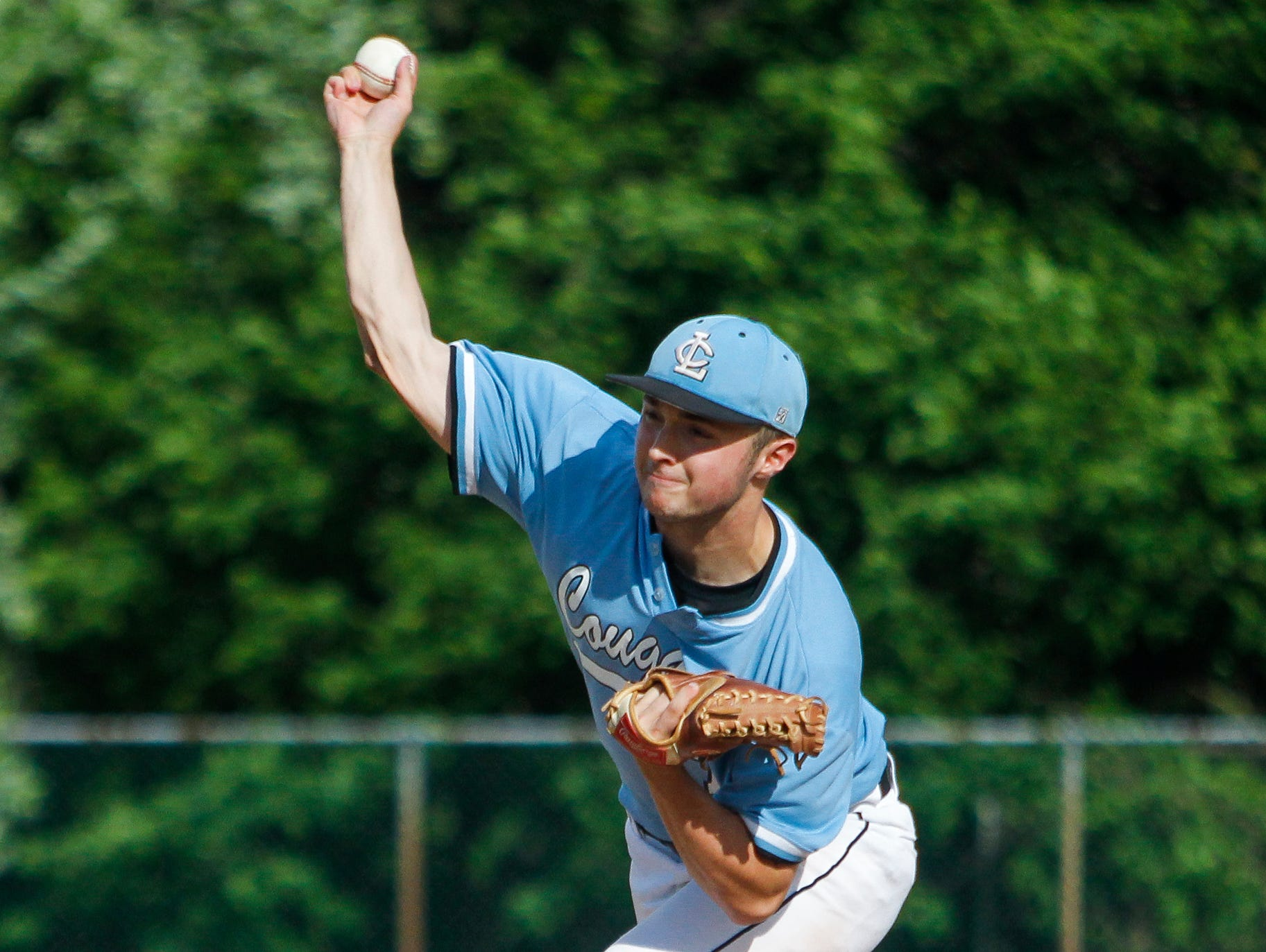 Lansing Catholic pitcher Riley Creamer unleashes a pitch against DeWitt in the 54th Annual Dean Shippey Diamond Classic May 18, 2015, at Kircher-Municipal Park in Lansing.
