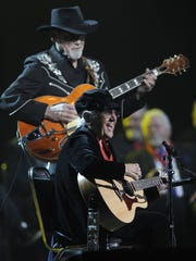 Duane Eddy and Corki Casey-O'Dell perform during a concert after being inducted into the Musicians Hall of Fame & Museum at the Municipal Auditorium on Tuesday Jan. 28, 2014 in Nashville, Tenn.
