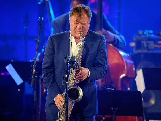 Igor Butman performs on stage during the International