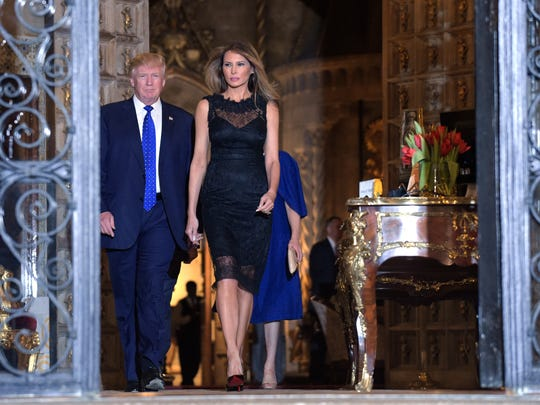 President Donald Trump and First Lady Melania Trump walk ahead of Japanese Prime Minister Shinzo Abe and his wife Akie Abe before they have dinner at Mar-a-Lago.