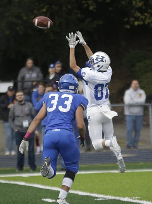 Highlands wide receiver Braden Posey (87) catches a pass during the Bluebirds' football game against Covington Catholic Saturday.