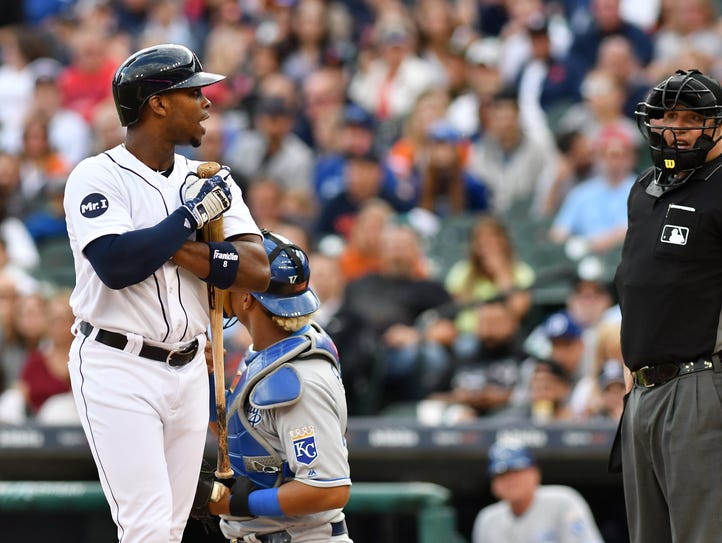 Tigers' Justin Upton, left, talks with home plate umpire