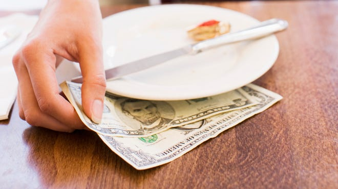 A waiter allegedly stole hundreds of dollars from customers at a Mount Laurel restaurant, police say.