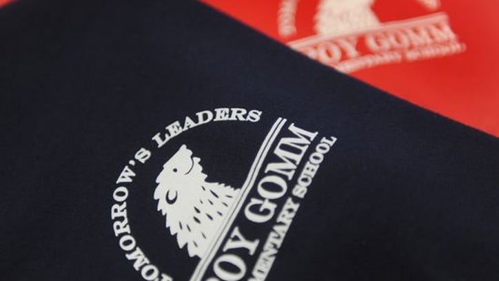 """Roy Gomm Elementary students won't be allowed to wear red and blue polo shirts with the phrase """"Tomorrow's Leaders"""" when school starts in a week."""