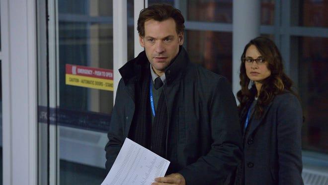 """Corey Stoll and Mia Maestro star in FX's """"The Strain."""""""