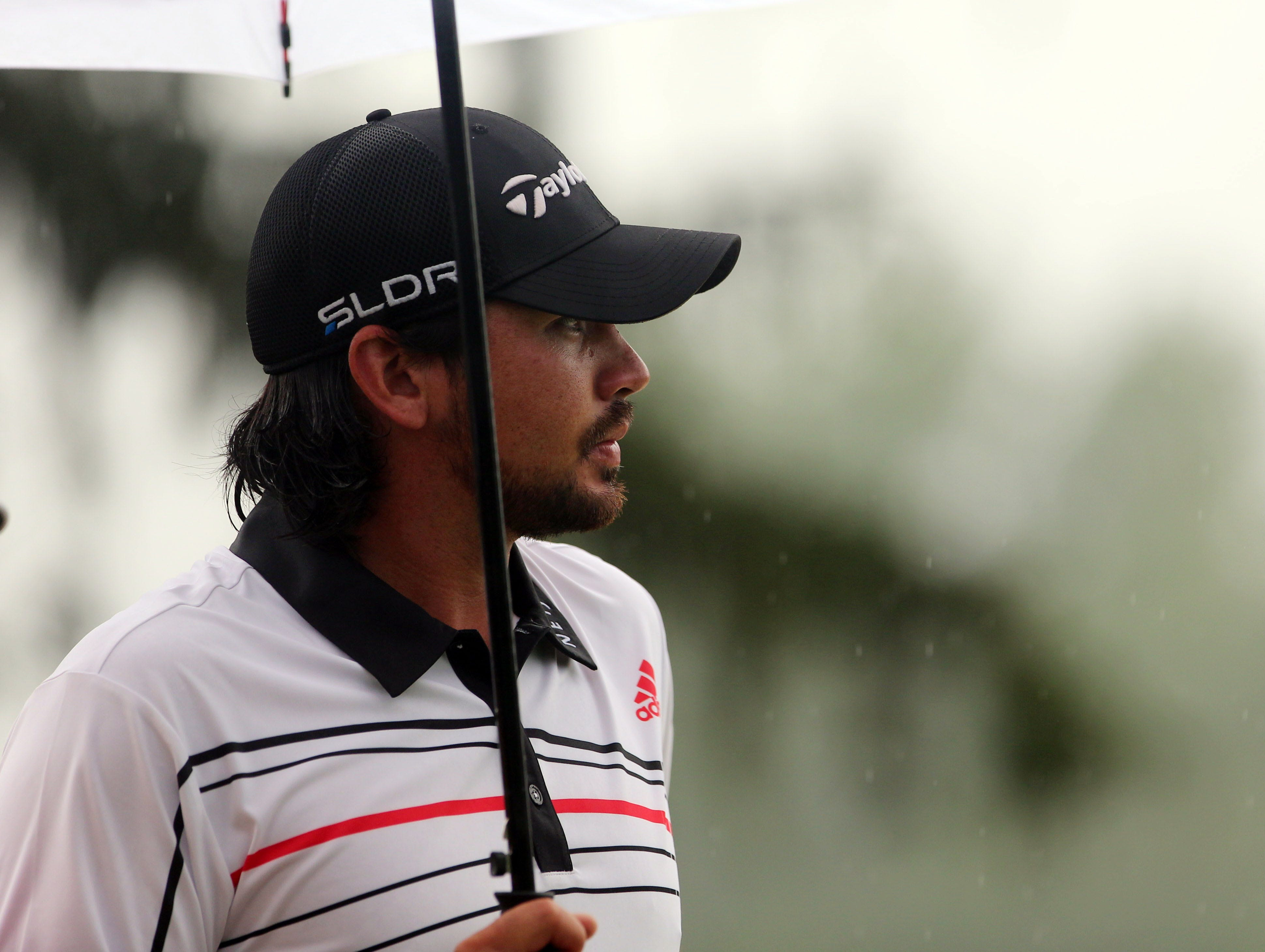 Jason Day walks off the 18th green.