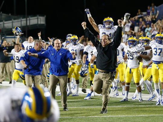 The Delaware bench erupts after the Blue Hen defense stopped James Madison on fourth-and-goal on the last play of Delaware's 30-23 OT win Sept. 27, 2014, at Bridgeforth Stadium in Harrisonburg, Va.