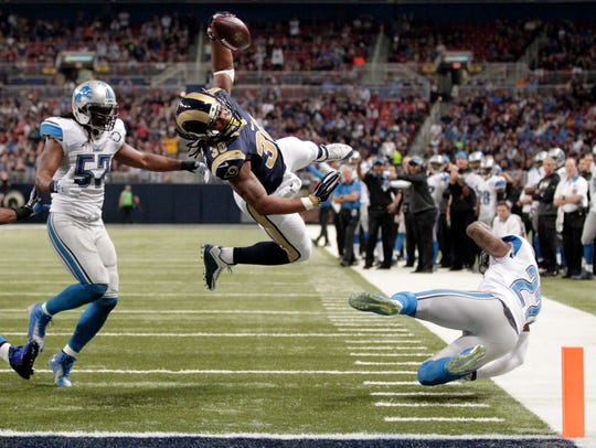 St. Louis Rams running back Todd Gurley, center, scores
