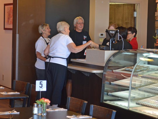 Bistro 163 volunteers join Chef Stacey Maple in prayer