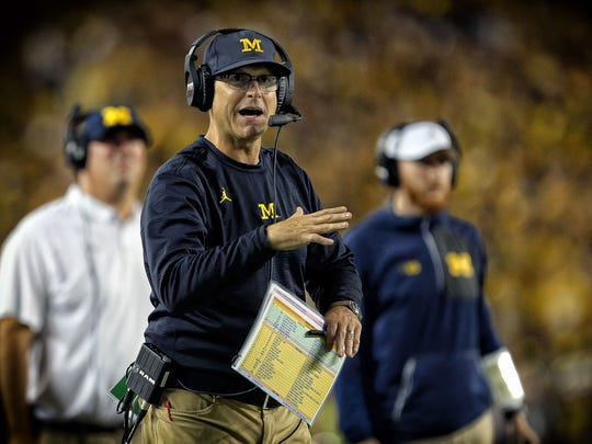 Michigan coach Jim Harbaugh stands on the sideline during the first half of a game against Michigan State at Michigan Stadium on Oct. 7, 2017 in Ann Arbor.