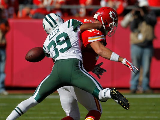 New York Jets cornerback Antonio Allen (39) forces Kansas City Chiefs tight end Travis Kelce (87) to fumble the ball which goes out of bounds, in the first half of an NFL football game in Kansas City, Mo., Sunday, Nov. 2, 2014. (AP Photo/Colin E. Braley)