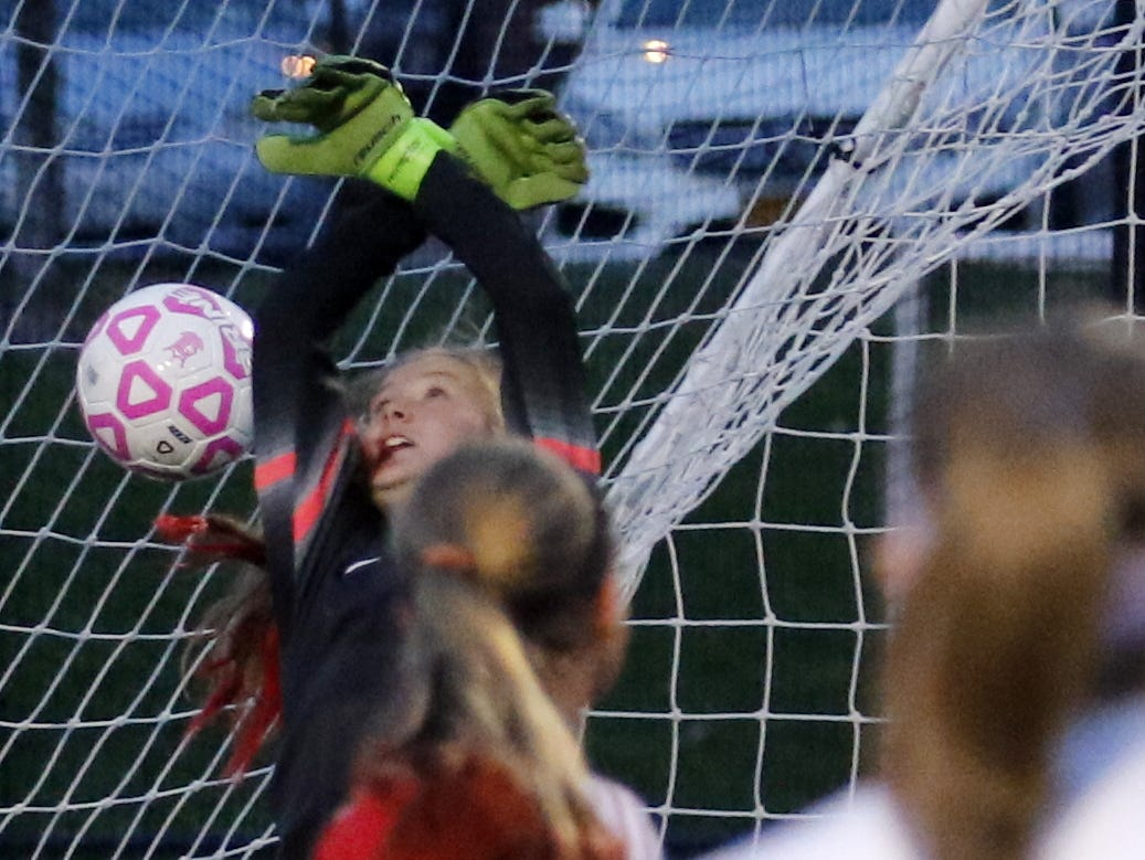 A free kick from Notre Dame's Emma Booth (foreground) slips through the hands of Sauquoit Valley's Allison Moreau for a first-half score in Saturday's section 4 Class C girls soccer quarterfinal at Dick Hoover Stadium in Vestal.