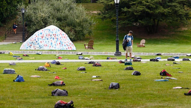 Sean Mehr of Pennsylvania reads one the many stories as Fairleigh Dickinson University placed over 1000 backpacks on the library lawn aimed at preventing suicides in a nationally recognized traveling exhibition of donated backpacks representing college students lost to suicide each year. FDU is the first of three NJ campuses that 'Active Minds' will be visiting to raise awareness, and the first overall on their trip of the East Coast. September 14, 2017, Madison, NJ
