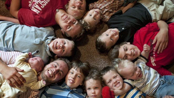 Twelve of the Schwandt brothers pictured in their Rockford home .