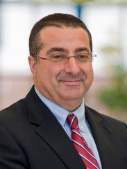 Dr. Lewis Reich
