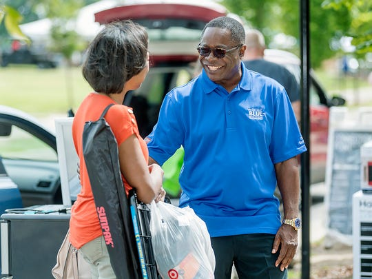MTSU President Sidney A. McPhee, right, visits with