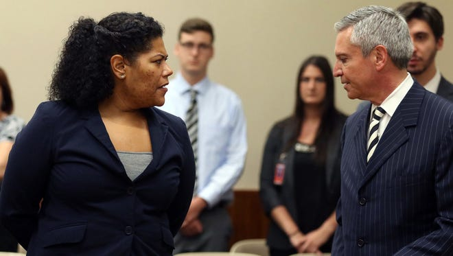 Judge Leticia Astacio of Rochester (N.Y.) City Court briefly speaks with her lawyer, Edward Fiandanch, before being escorted June 5, 2017, to Monroe County Jail in Rochester, N.Y.