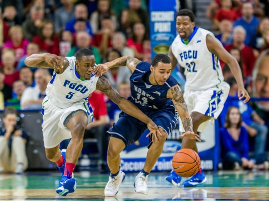 FGCU's defense will gamble more this season as the Eagles look to speed-up foes. Eagles sophomore point guard Zach Johnson goes after UNF's Dallas Moore,  the ASUN Player of the Year, in a game last season.