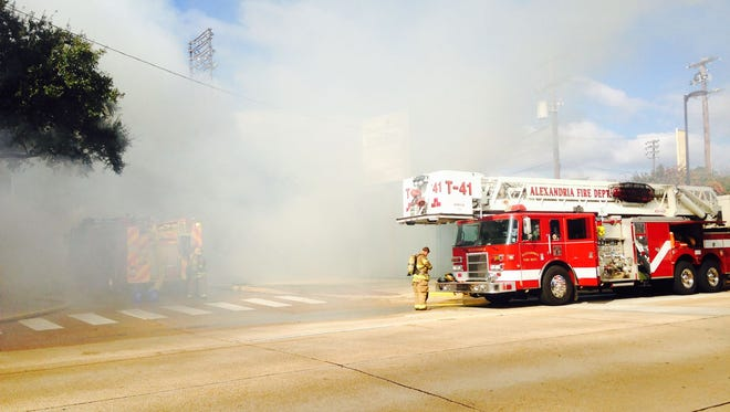 Firefighters try to contain the fire that broke out Saturday at historic Bringhurst Field in Alexandria.
