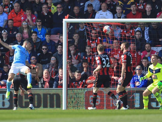 Manchester City's Sergio Aguero, left, scores his side's third goal during their English Premier League match against Bournemouth at the Vitality Stadium, Bournemouth, England, Saturday, April 2, 2016. (Adam Davy/PA via AP)     UNITED KINGDOM OUT      -    NO SALES      -       NO ARCHIVES