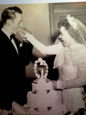 William O. and Ceedie Rae Smith share their wedding cake.