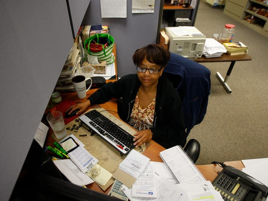 Sharon Favor-Byrd of Irondequoit, claims manager, work at Paris-Kirwan Associates Inc. in Rochester on Thursday.
