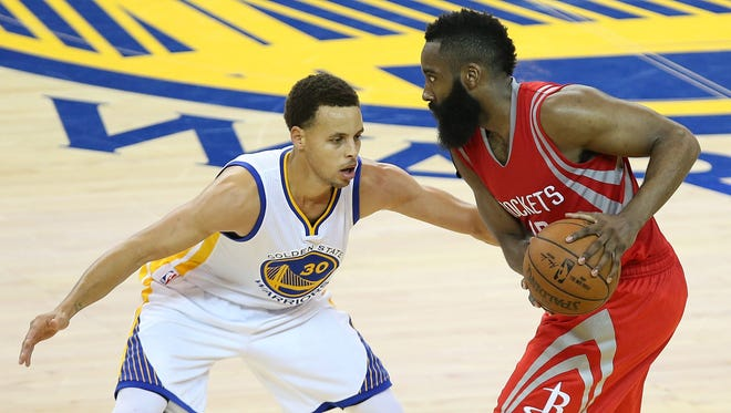 May 21, 2015: Houston Rockets guard James Harden (13) controls the ball against Golden State Warriors guard Stephen Curry (30) during the second half in game two of the Western Conference Finals of the NBA Playoffs. at Oracle Arena.