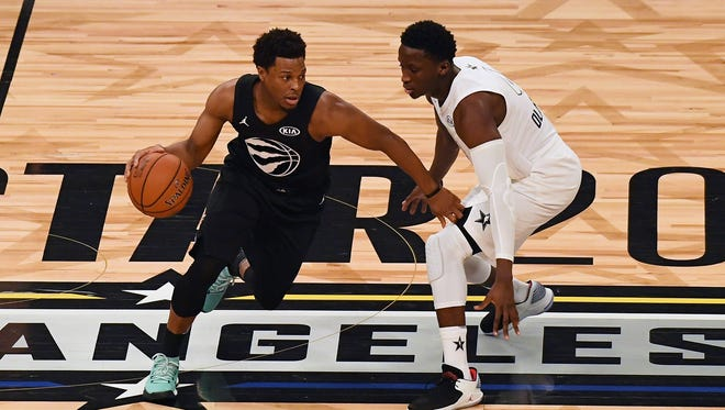 Team Stephen guard Kyle Lowry of the Toronto Raptors (7) controls the ball against Team LeBron guard Victor Oladipo of the Indiana Pacers (4) in the first half during the 2018 NBA All Star game at Staples Center.