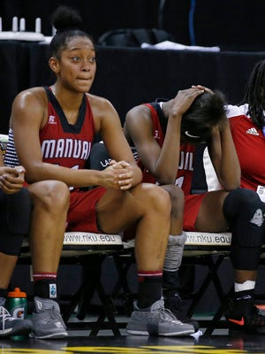 Manual's Nila Blackford, left, and Aniah Griffin sit on the bench in the final minutes of their loss to Boyd County during a quarter final game in the St. Elizabeth Healthcare/KHSAA Girls' Sweet 16 basketball tournament played at BB&T Arena in Highland Height, Ky. Friday March 9, 2018.