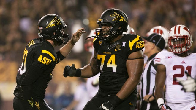 Arizona State quarterback Taylor Kelly and Jamil Douglas celebrates after a touchdown against Wisconsin at Sun Devil Stadium on Saturday, Sep. 14, 2013 in Tempe.