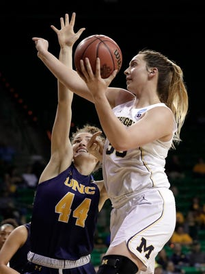 Northern Colorado's Bridget Hintz defends against a shot by Michigan's Hallie Thome in the first half of the NCAA women's tournament in Waco, Texas, Friday, March 16, 2018.