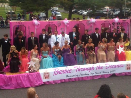 Students arrive in style on a Barbie themed float at