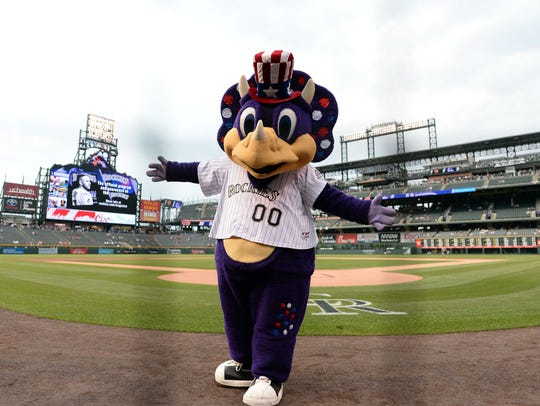 Colorado Rockies mascot Dinger entertains fans before