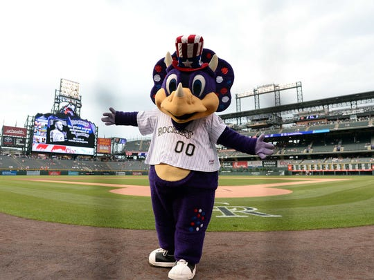Colorado Rockies mascot Dinger entertains fans before a game against the San Francisco Giants at Coors Field.
